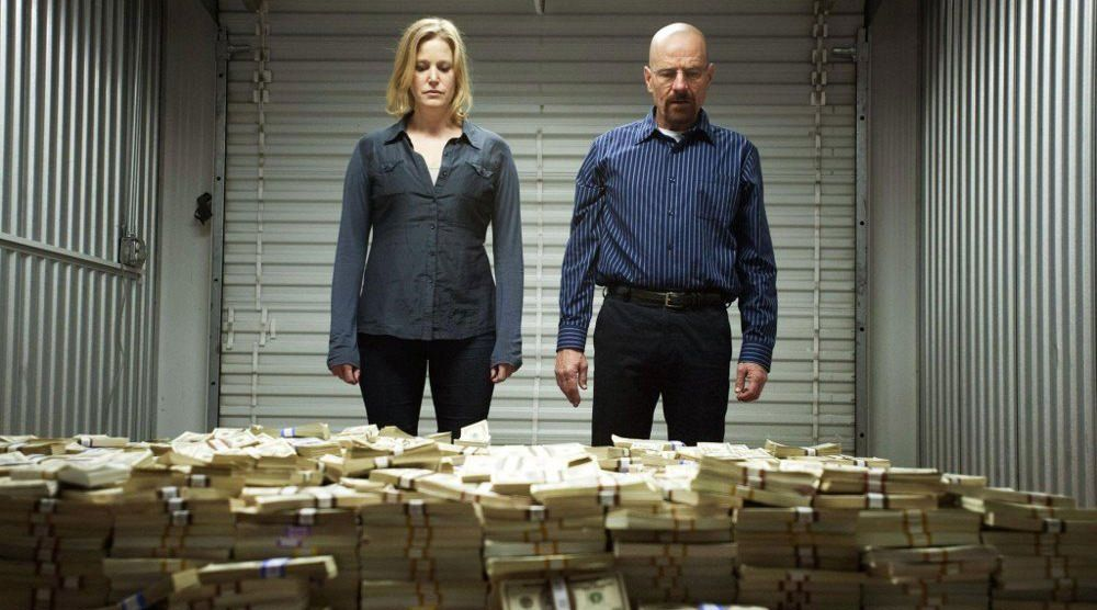 Breaking-bad-scene-where-Walter-White-and-Skylar-stand-in-front-of-a-huge-pile-of-cash copy