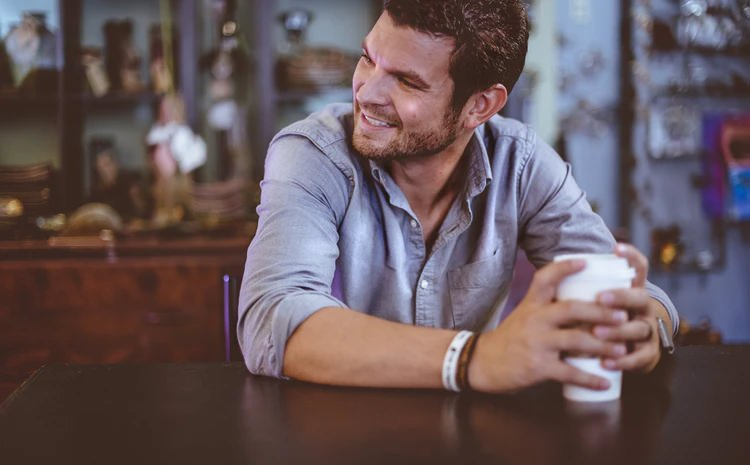 man-enjoying-coffee-smiling
