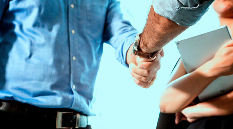 handshake-of-two-men-in-business-suits-partnership-deal-teamwork-team-successful-male-cooperation_t20_kROZ1K copy