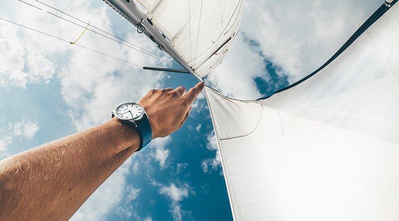 hand-touching-boat-sail