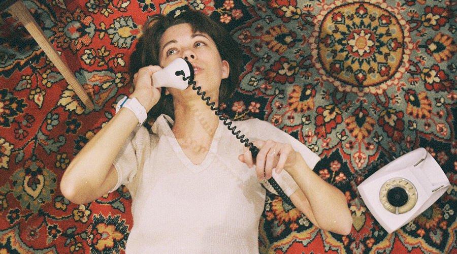 girl-on-phone-on-rug